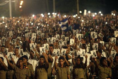 Military cadets hold up pictures of Fidel Castro at the Tuesday tribute.