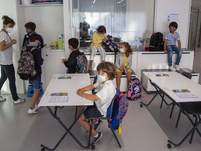 Young children on their first day of school in San Sebastián, in Spain's Basque Country region.