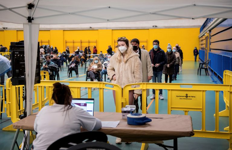 Members of the public await their coronavirus test results in Palma.