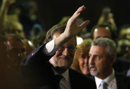 Mariano Rajoy greets supporters after being voted in the new prime minister of Spain.