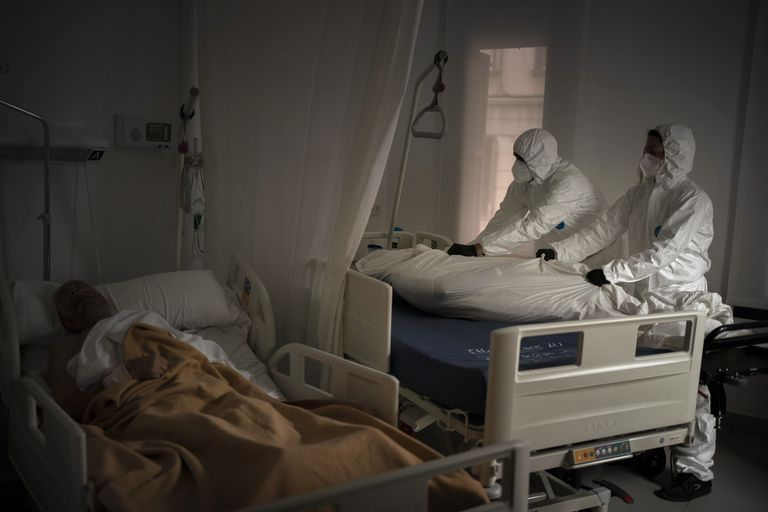 Funeral home workers remove the body of an elderly person who died of Covid-19 at a nursing home in Barcelona.