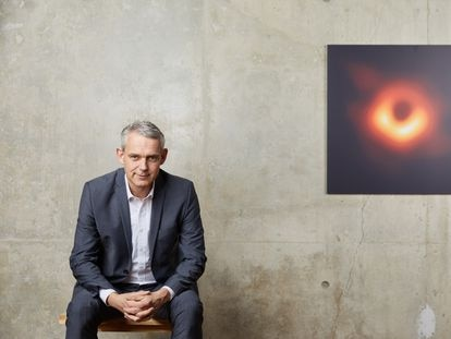 The German astrophysicist Heino Falcke with the first image of a black hole.