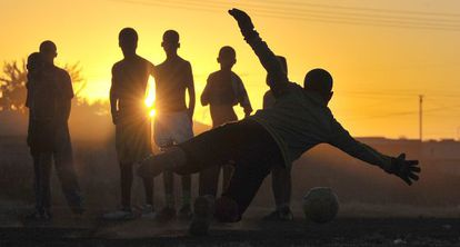 Children playing soccer in South Africa.