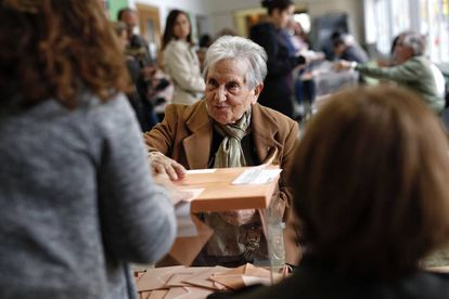 A woman voting in Barcelona on Sunday.
