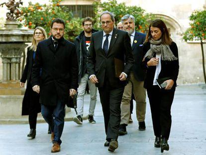 (l-r) Catalan deputy premier Pere Aragonès, premier Quim Torra and regional government spokesperson Meritxell Budó.