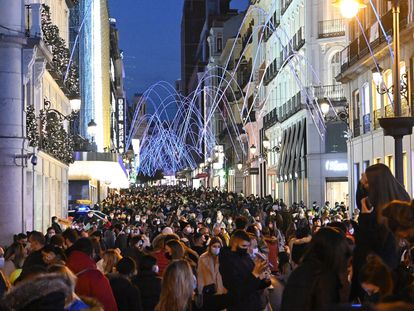 Packed scenes in Preciados street in Madrid.