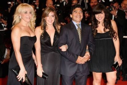 Maradona with Claudia Villafañe (l) and their two daughters, Dalma and Gianinna.