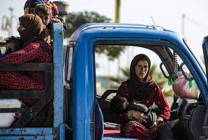 Syrian families flee the conflict zone in the north of the country.