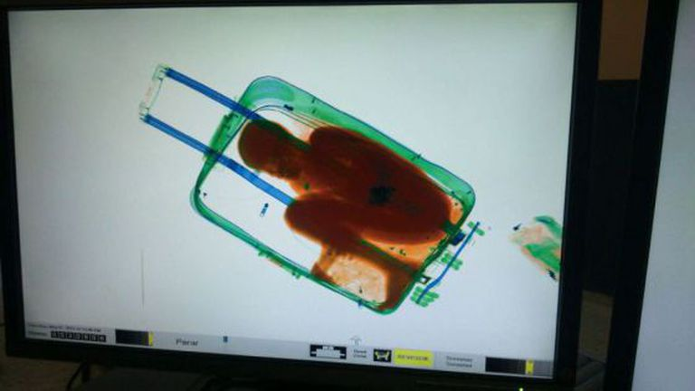 A security scanner image of eight-year-old Abou inside the suitcase.