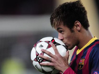 Barcelona forward Neymar kisses the match ball after his hat-trick against Celtic.