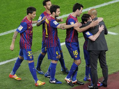 Barcelona's players celebrate with  coach Josep Guardiola after scoring a goal against Espanyol.