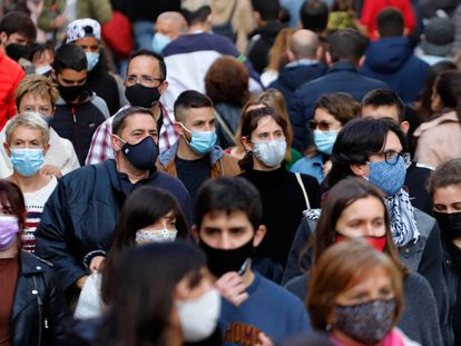 Pedestrians wearing face masks in a shopping strip of Barcelona, in April.