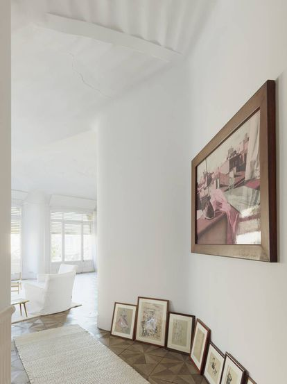 The author's art collection on the white walls of her apartment.