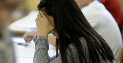 A file image of a girl doing an exam.