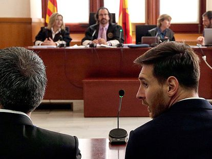 Messi and his father, Jorge Horacio, in court on Thursday.