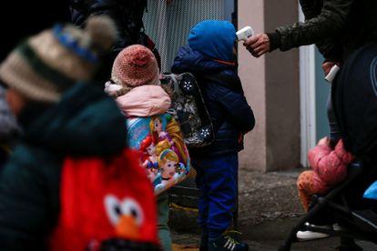 Children have their temperature taken at Rubén Dario school in Barcelona.