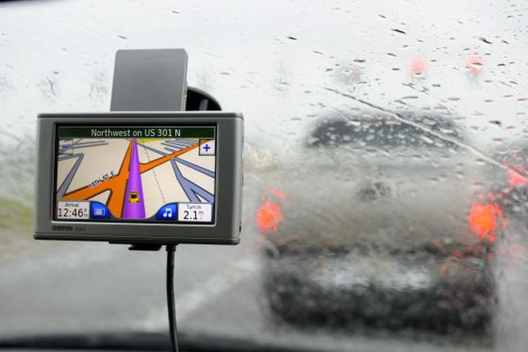 A GPS device on the windshield of a car.