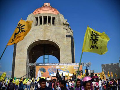 Supporters of the leftwing PRD protest against a constitutional reform proposed by President Peña Nieto to open up state oil monopoly Pemex to foreign investment.