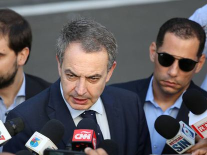 Former Spanish Prime Minister José Luis Rodríguez Zapatero talks to the media before attending Venezuela's government and opposition coalition meeting in Santo Domingo.