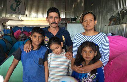 Rafael Castillo, Georgina Ayala and their children in a shelter in Tijuana.
