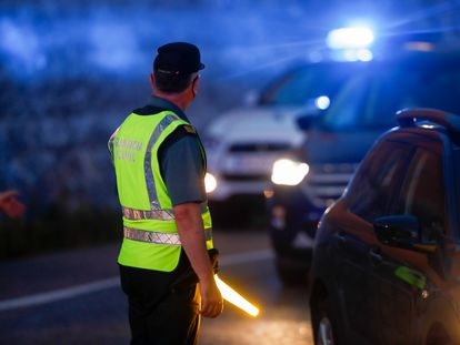 A Civil Guard officer controlling access to the A-4 highway in Madrid in October.