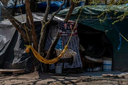 A poster supporting the presidential campaign of Joe Biden and Kamala Harris hangs off a tent in the camp in Matamoros.