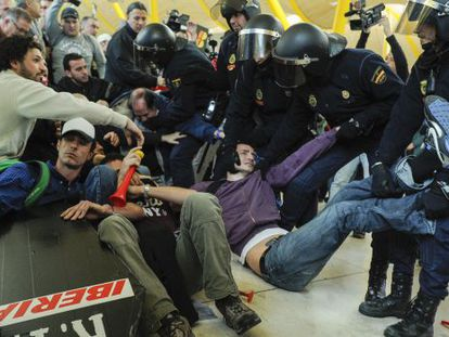 Strikers of Spanish airline Iberia clash with baton-wielding police at Madrid-Barajas airport on Monday.