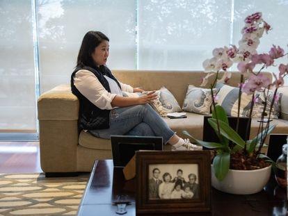 Keiko Fujimori in her apartment in Lima. In the foreground, a family portrait with her father, Peru's last autocrat Alberto Fujimori.
