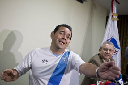 Jimmy Morales, pictured wearing the Guatemala national soccer team jersey.