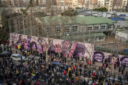 Residents protest against plans to remove the mural on Sunday.