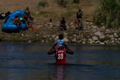 A Haitian man and his son crossing the Rio Grande on Thursday.
