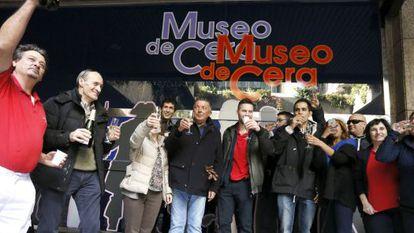 Museo de Cera staff celebrate their lottery win.