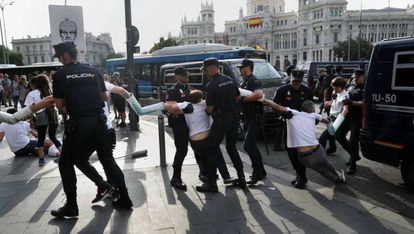 Police clear environmental protestors in Madrid on Monday.