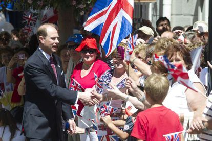 Britain's Prince Edward, Earl of Wessex (L) greets people as he arrives in Gibraltar June 11.