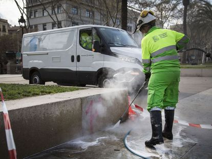 A sanitation worker cleans the streets in Barcelona.