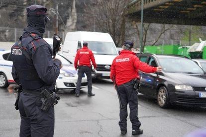Basque regional police officers control the perimetral lockdown of Bilbao.