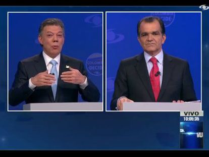 Santos (left) and Zuluaga during the televised debate.
