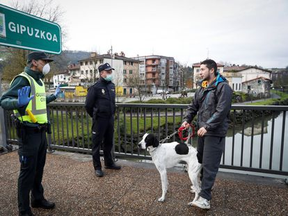 Police stopping a man from crossing the border between Spain and France on Tuesday.