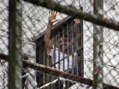Venezuelan political opposition leader Leopoldo Lopez in the window of his prison cell in 2014.