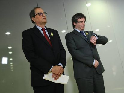 Newly elected Catalan premier Quim Torra and Carles Puigdemont.