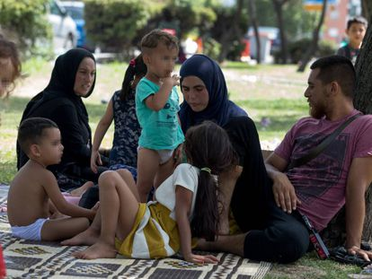 The Syrian refugees in a Madrid park.