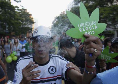 A man celebrates the passage of the marijuana legalization law last month.