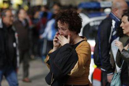 A woman speaks on a cellphone outside the high school in Barcelona.
