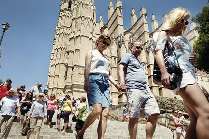 Tourists near the Cathedral of Santa Maria of Palma.