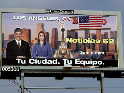 "An American flag has been placed over the word ""Mexico"" on this billboard in the US."