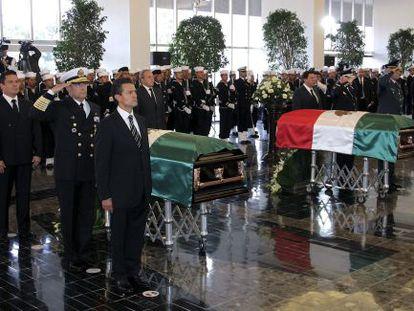 President Enrique Peña Nieto (left) presides over funeral ceremonies Monday for Deputy Admiral Carlos Salazar and his bodyguard Francisco Ricardo Hernández.