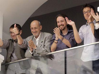 Podemos members (from left to right) Juan Carlos Monedero, Jesús Montero, Pablo Iglesias and Íñigo Errejón applaud the investiture of Manuela Carmena.