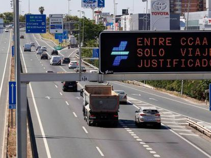 """Only justified travel allowed between regions,"" reads this sign on the S30 highway to Seville."