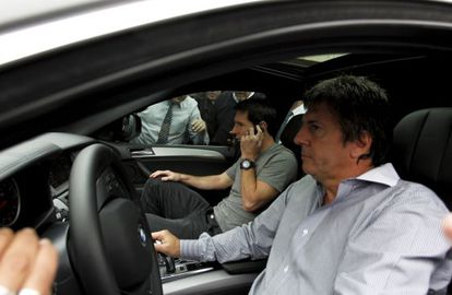 Leo Messi alongside his father, Jorge.