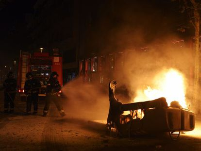 Protesters set a container on fire in Barcelona's Gràcia neighborhood.